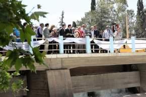 Bendición del agua y lanzamiento de ofrendas florales al dique José I. de la Roza